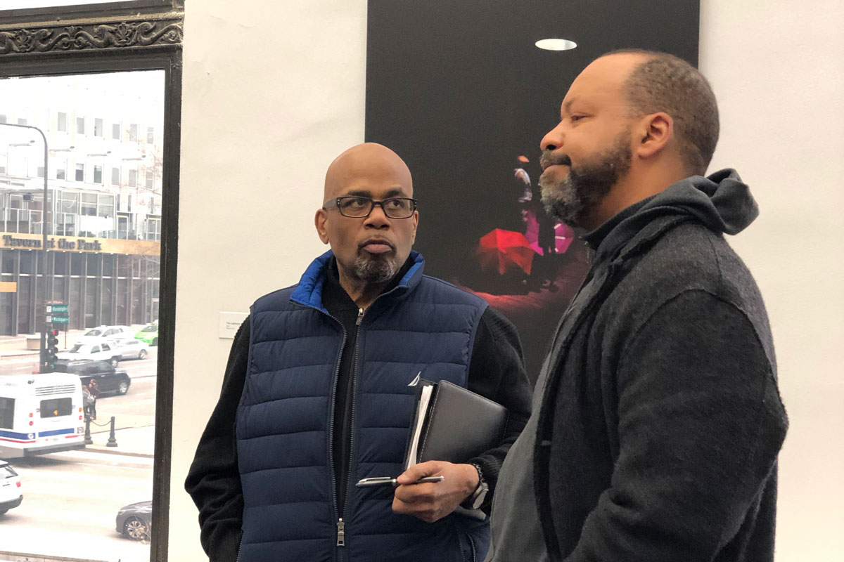 Chicago Peace Fellow Robert Biekman (left) discusses the role of the arts in social change with noted photographer Cecil McDonald, Jr. during a tour of his exhibit In the Company of Black at the Chicago Cultural Center.