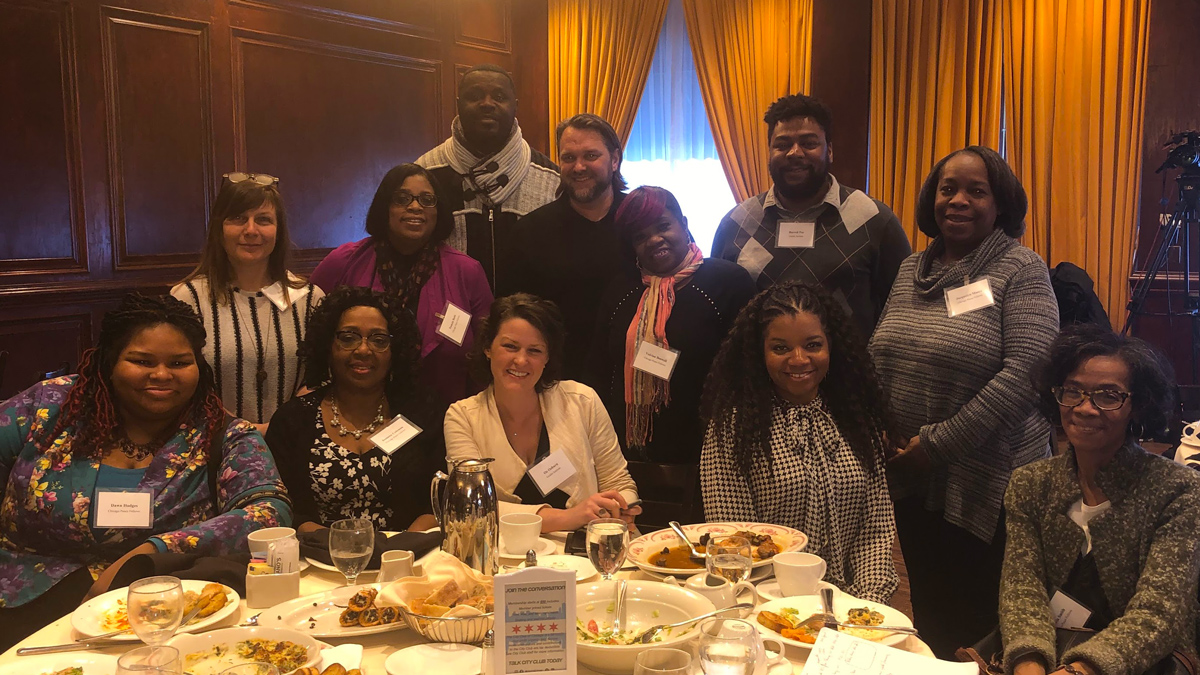 Chicago Peace Fellows Dawn Hodges (from left), Robin Cline, Jeanette Coleman, Pamela Butts, Johnny Coleman, staff member Oz Ozburn, Executive Director Travis Rejman, Velvian Boswell, Jamila Trimuel, Coordinator Burrell Poe, Jacquelyn Moore and Gloria Smith participate in the CrimeLab presentation at the City Club of Chicago.